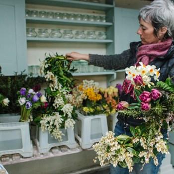Rachel arranging flowers in studio