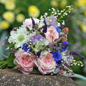 Summer bridal bouquet with cornflowers, peonies